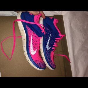 Pink and purple nike athletic shoes
